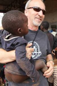 Me, and a little guy at our pop-up medical clinic at Acholi Quarter. Excuse the wardrobe malfunction.